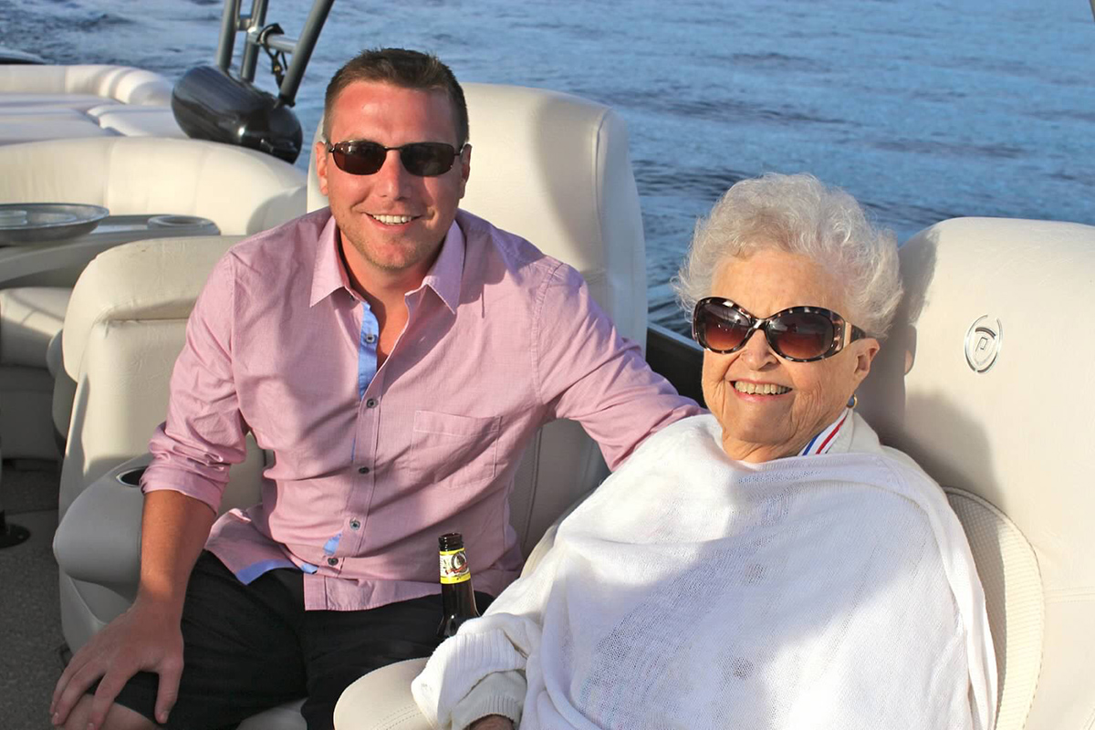 Tim with his beloved Grandma Nonny on a boat