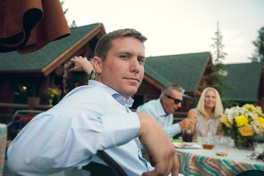 Timothy O'Shaughnessy at an outdoor dinner looking back to the camera